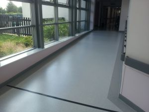 Gerflor Tarasafe Ultra with a border installed to a corridor