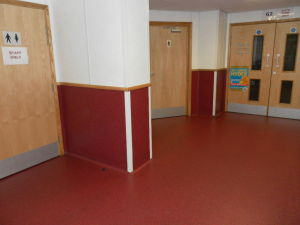 Gerflor Tarasafe Ultra with 1 metre coved skirting installed in a school corridor