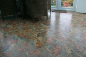 Karndean Knight Tile with feature strip installed in a conservatory