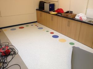 A Local school wanted something different. We installed Tarasafe Ultra sheet vinyl with different colours and size circles to create a border around their classroom and cloakroom